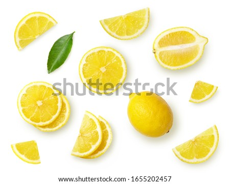 A set of sliced lemon isolated on white background. Top view.