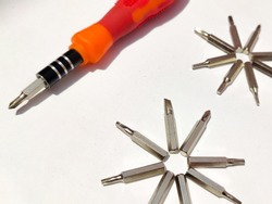 A set of small screwdrivers. metal screwdriver bits.Multi-bit repair tools kit set torx screwdrivers for gadgets isolated on a white background, Set of heads for screwdriver (bits) , selective focus.