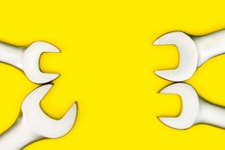 A set of Spanners On a Yellow Background, with space for text.
