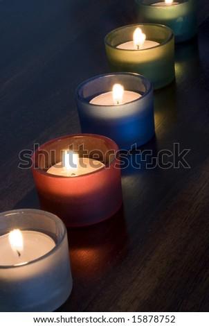 a set of 5 tea light candles