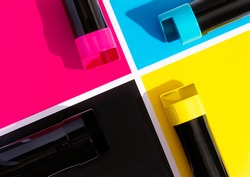 A set of toner cartridges for a color laser printer on the background of SMYK. bright creative concept minimal