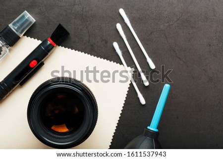 A set of tools to take care of your camera lenses on a dark background.