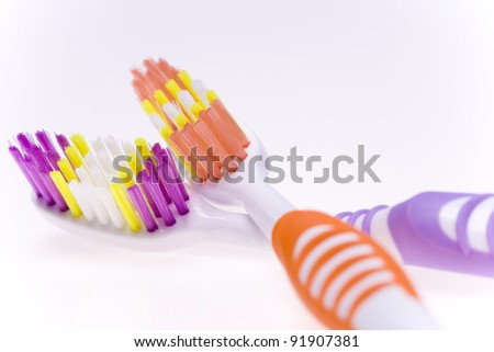 A set of toothbrushes isolated on white - stock photo