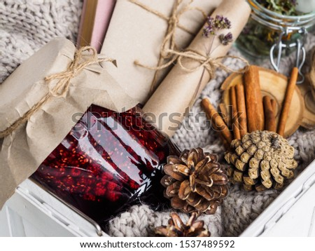 A set of useful ingredients for treatment at home. Jam and dry herbs for brewing tea. Book and envelope. Cozy atmosphere in winter and autumn. #1537489592