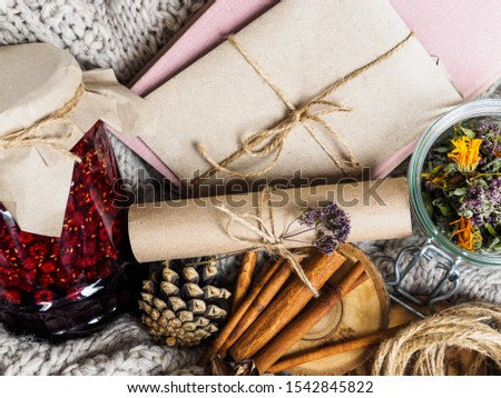 A set of useful ingredients for treatment at home. Jam and dry herbs for brewing tea. Book and envelope. Cozy atmosphere in winter and autumn. #1542845822