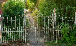 A set of very rusty gates in a country garden