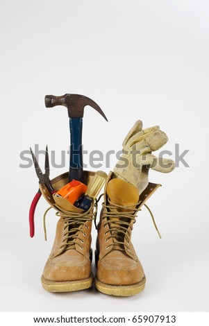 A set of work boots and tools for the do it yourself person.