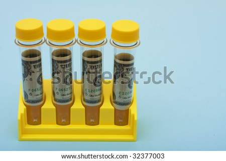 A set of yellow test tubes on a blue background, medical research costs
