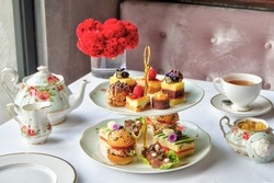 A set selection of finger sandwiches, petit fours, sweet and savory pastries, scone with preserve and clotted cream, tea, or coffee. Tea Selection included.