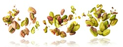 A set with Flying in air fresh raw whole and cracked pistachios  isolated on white background. Concept of Pistachios is torn to pieces close-up. High resolution image