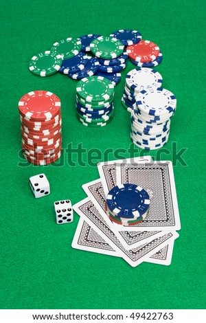 A setting of a poker game shows cards down and bet placed on top of the cards.