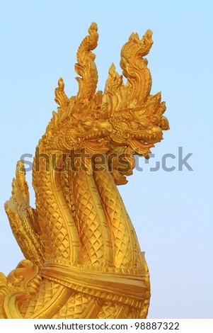 A seven-headed dragon statue in the temple.