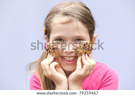 a seven-year-old girl eating chocolate cookies