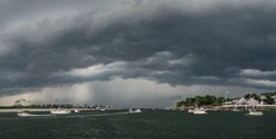 A severe summer squall approaches Annisquam in Gloucester, Massachusetts.