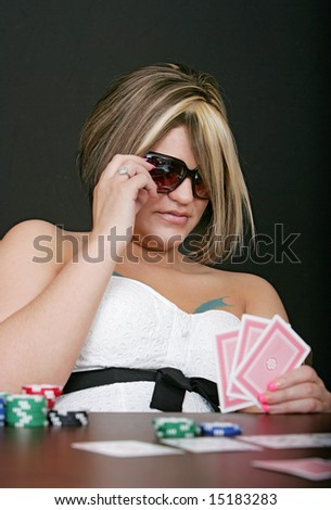 stock photo : a sexy adult female with sunglasses playing cards over a black ...