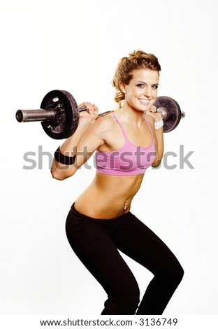 a sexy girl is doing exercise with weights