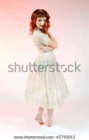 A sexy pin up girl in a sheer white dress.