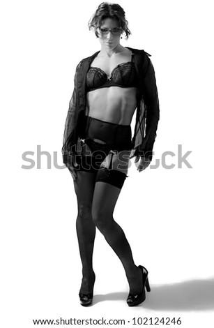 A sexy schoolteacher in black lingerie and heels