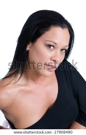 A sexy woman dressed in black gazes into the camera sensually.
