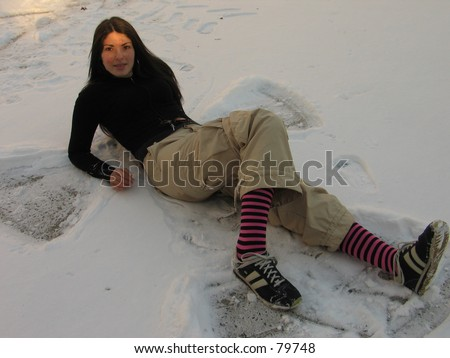 A sexy woman outside in the snow in New York City, having lots of fun