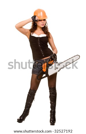 A sexy worker woman with the motor saw, isolated on white studio background.