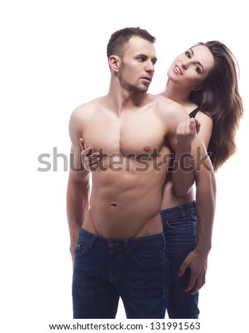 A sexy young topless couple embracing in jeans