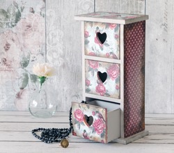 A shabby chic mini chest of drawers decoupaged in a vintage floral pattern