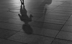 a shadow of a girl with a hula hoop