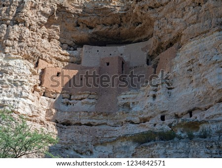 A shadowy close shot of Montezuma's Castle cliff dwelling on the side of a mountain.