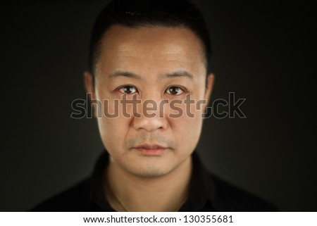 A shallow depth of field close up portrait of a young Asian man