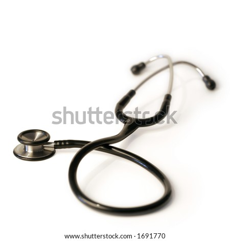 A shallow depth-of-field image of a stethoscope on white background.