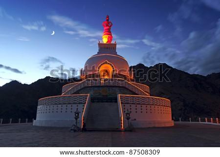 A Shanti Stupa in night time. Leh, Ladakh, India - stock photo