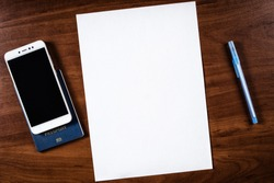 a sheet of A4 paper on the table and a passport with a pen, a sheet of A4 paper and a passport with a mobile phone, a blank A4 sheet and a passport with a pen near it, not filled sheet A4