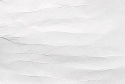 A sheet of white recycled wrinkled cardboard, white clean poster paper texture