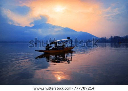 A Shikara boat on Dal lake in Srinagar, Jammu and Kashmir, India