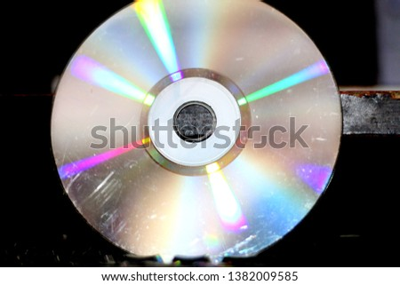 a shining disc with blurred black background