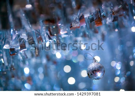 A shiny ball decoration with blur bokeh background #1429397081
