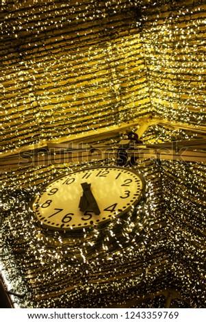 A shiny clock and a shiny roof #1243359769