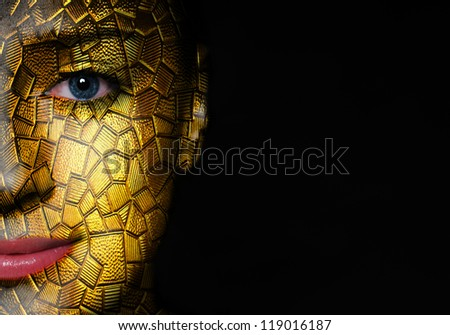 A shiny glass texture with mosaic tile pieces over woman face
