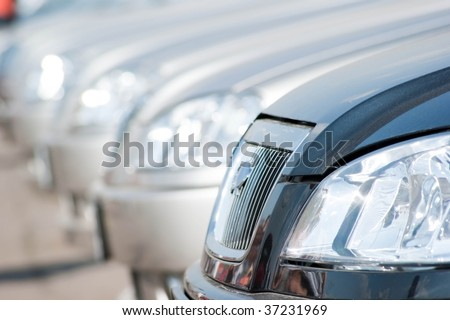 A shiny row of cars.