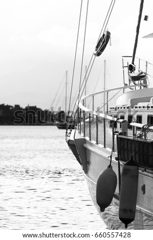 A ship in port, the deck and the hill on the horizon. Black-and-white background of sea travel #660557428
