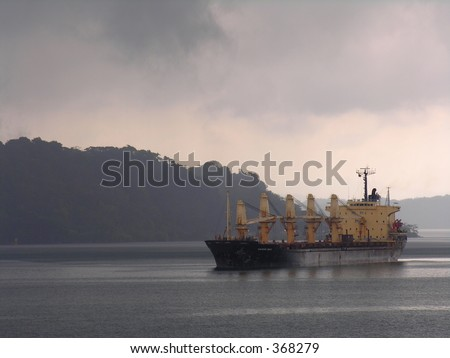 A ship in the Panama Canal during a tropical shower