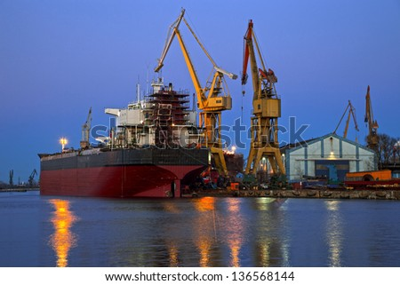 A ship is repaired in shipyard.