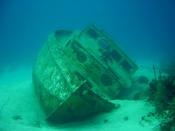 A shipwreck laying in the bottom of the sea