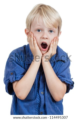 A shocked and surprised young boy looking at the camera. Isolated on white.