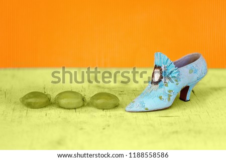 A shoe beside squashed green grapes as a conceptual image for stomping on healthy fruit and rejecting it