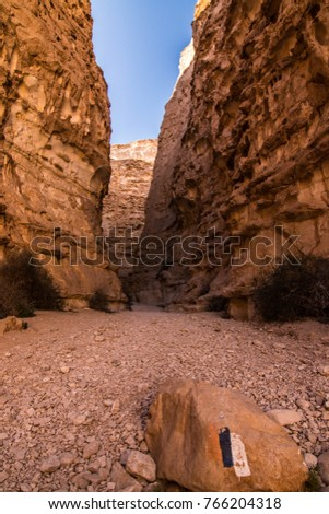 A shoot of Barak canyon with the Israel national trail mark on a rock, taken in the Arabah, Israel national trail. #766204318
