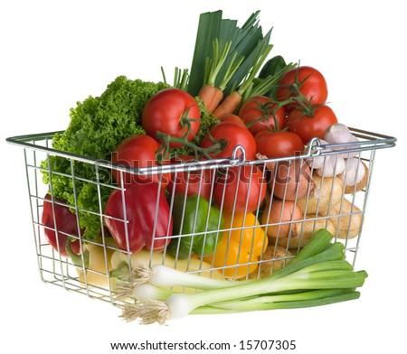 A shopping basket full of fresh colorful vegetables isolated on white background.