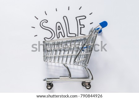 A shopping cart carrying hand drawn SALE type for promotional use.