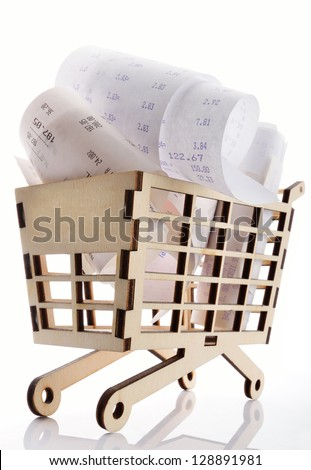 A shopping cart full with bills